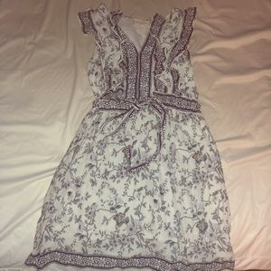 Cute white floral dress with ruffling at the top!
